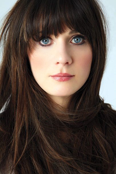 Cute in Theory: Zooey's adorable bangs can become a nightmare if you have a cowlick or curly hair. credit: EW.com