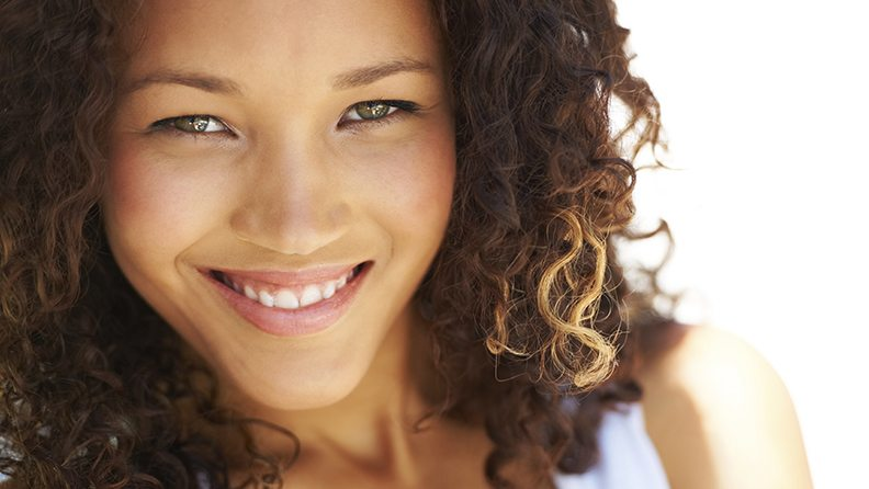 Naturally gorgeous young woman looking at you with a smile
