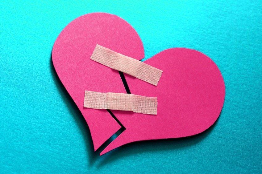 Broken heart fixed with adhesive bandage