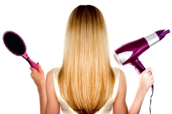 blonde-woman-holding-brush-and-hair-dryer