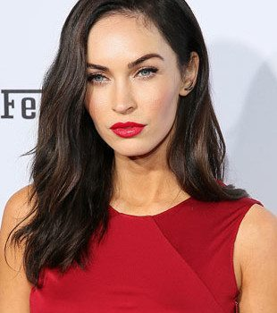 Keep it simple like Megan Fox, with bold lashes, great brows, and red lipstick.