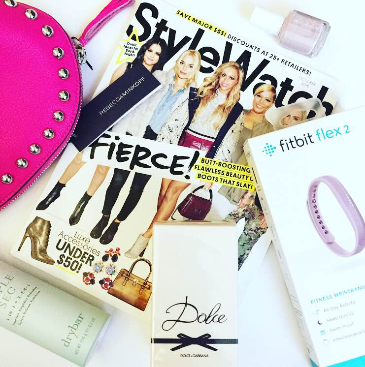 Amazing goodie bag featuring Rebecca Minkoff, DryBar, FitBit, Perfumania, StyleWatch and Essie nail polish.