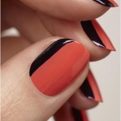 Try a simple dual colored manicure using contrasting colors. credit: cuteneasynaildesigns.com