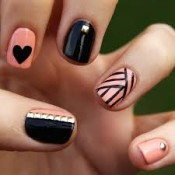 Try mismatched designs and embellishments for a DIY manicure that is anything but boring. credit: nailideas2014.com