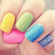 Use multiple colors and glitter to create a fun, simple spring manicure. via pinterest