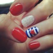 Easy to do and perfect for resort. Use a toothpick to create a heart and stripe accent nail. credit: stylelist.com